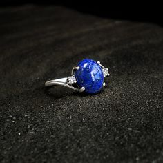 Elena: Lapis and Sterling Ring - white CZ accent, sterling silver swirl, twist, lapis lazuli, vampire diaries, sunlight, dark blue, december *see if they could use white saphire instead of CZ and how much a stronger metal would cost?