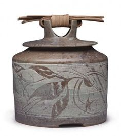 Mea Rhee.  Storage jar with herons, 8 in. (20 cm) in height, wheel-thrown dark stoneware with illustrations carved into white stoneware slip, and-woven...