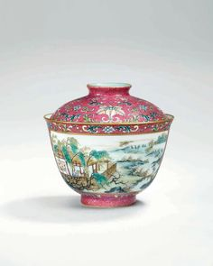 A fine and rare sgrafiatto ruby-ground famille rose bowl and cover, China, Qing dynasty, Qianlong mark and of
