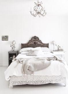 Neutral white vintage inspired bedroom