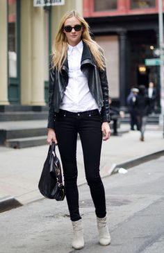 Heather Marks wears a Yigal Azrouel jacket, Tripp jeans, Rag & Bone boots, Ray-Ban sunglasses, and a Givenchy bag.