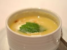 Chilled pineapple lychee soup with Malibu scented cream and toasted coconut