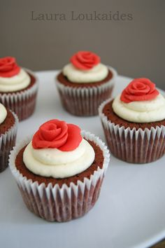 Rosy Red Velvet Cupcakes - Squishy Red Velvet cupcakes, topped with a special cream cheese topping, decorated with a little fondant rose.