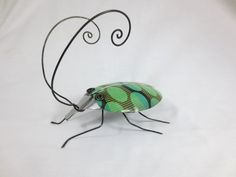Green Funky Spoon Beetle With Crazy Wing Casings Repurposed Art. $42.00, via Etsy.