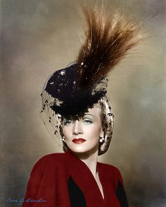 Marlene Dietrich. Don't know about this hat. Love the feathers.