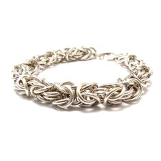 A very intricate looking chainmaille.  It is a prerequisite skill for the byzantine diamond pattern.