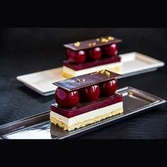 "Individual cake ""Bird's milk"" (classic Russian cake with new style): almond-lemon sponge cake; lemongrass syrup; special lemon mousse with agar-agar ""Bird's milk""; raspberry jelly; chocolate elements."