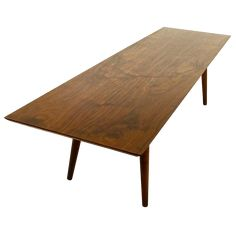 "$400 in Los Angeles Rectangular coffee table with walnut finish. Minimalist and modern silhouette.  Dimensions 48""W X 18""D X 15"" HT"