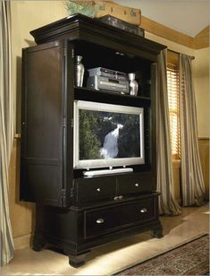 Repurpose a TV Armoire | Potentially Beautiful  (I like the shelf above the TV)