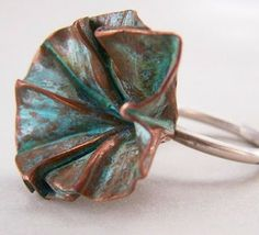 Secret Life of Jewelry - A Universe of Handcrafted Art to Wear - beautiful form folded flowers by Cynthia Del Giudice