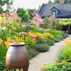 Pea gravel walkways are my favorite in a garden.  I also love the overflow of flowering plants.