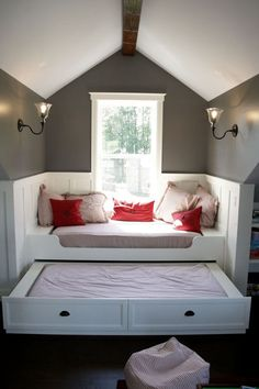 Day bed with a pull-out bed drawer underneath