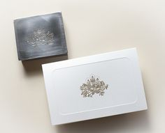 Hand-engraved die of Christmas candles and mistletoe and the gold-printed card. Picture taken at Pineider's workshop.