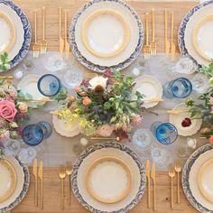 Tabletop details Our Blue Fleur de Lis Chargers + White Lace Dinnerware + 24k Gold Glass Dinnerware + 24k Gold Collection Flatware + Vintage Light Blue Goblets + Czech Crystal Stemware + Antique Crystal Salt Cellars   By Casa de Perrin