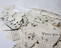 I'll write the sheet music for our songs for the wedding; print then die-cut heart them for the centre-pieces? Maybe?