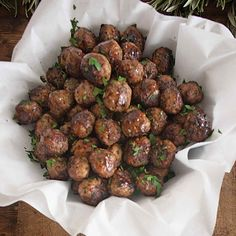 Three types of ground meat, aged cheese, and fresh herbs converge for a meatball that's light yet super flavorful.