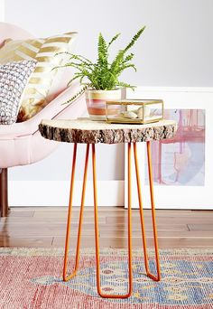 DIY log slice table with orange hairpin legs.