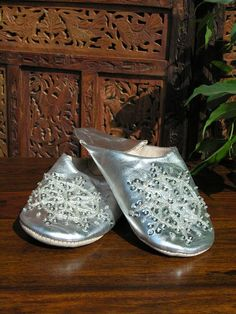 Large silver leather sequinned Moroccan slippers. http://www.maroque.co.uk/showitem.aspx?id=ENT01825&p=01571&n=all