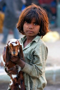 "Pakistani Boy and his ""pet"" goat (which the family will likely use for milk and eventually end up eating -- And although the child understands this, the goat is still his friend)."
