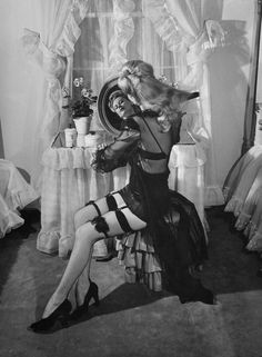 From 1944 - a wonderful combination of sheer lace gown and suspenders. Timeless!