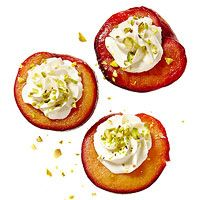 Stuffed Plums--Wrap pitted plum halves in foil. Roast at 450 degrees , cut side up, until soft, about 15 minutes. Let stand in foil 5 minutes. Whisk goat cheese, a drizzle honey and a splash nonfat milk until creamy. Spoon into plums. Top with chopped toasted pistachios.