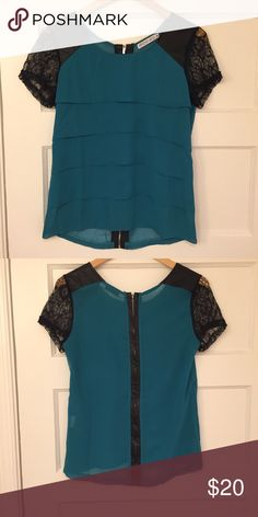 Teal and Black top Gorgeous teal and black top with lace sleeve detail. Faux leather on shoulders and on zipper that goes down the back. Perfect for date nights!!! Fond Tops