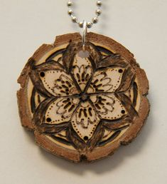 Mandala 7. $18.00, via Etsy.    pyrography, wood burned necklace, handmade