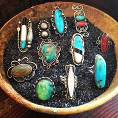 A bowl of vintage rings at the shop...> I haven't been yet but just seeing this pic makes me know the shop is heaven!!
