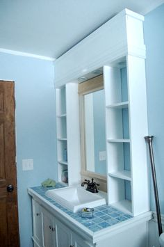 I like the idea of the storage around the mirror.  Would be good for my small bathroom!