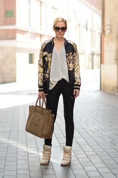 Bomber jacket by Zara, top by Mango, jeans by The Kooples, purse by Celine, sneakers by Isabel Marant. (ohmyvogue.com, March 3, 2013)