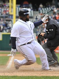 Tigers first baseman Prince Fielder is safe sliding into home on a sacrifice fly by Jhonny Peralta in the eighth inning. (Robin Buckson / The Detroit News)