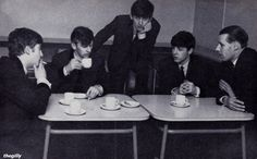 The Beatles and George Martin have tea at EMI Studios, 5 March 1963. Photo by John Dove
