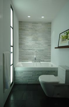 I really like covering a smaller wall with tile or stone. It creates a statement and makes the wall feel bigger. (True!)