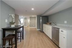 This is a perfect basement space for entertaining or an in-law suite! #creativeurbanliving