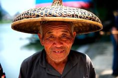 An elderly Chinese man wearing a hat