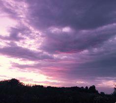 Sky through pink sunglasses