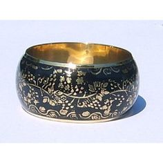 We love to wear this black and gold bangle to dress up a casual outfit and make it more exciting! Gold Bangles, Decorative Bowls, Casual Outfits, How To Make, How To Wear, Dress Up, Bracelets, Black, Casual Wear