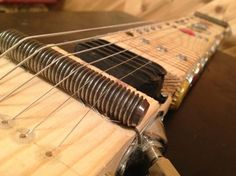 Last week, I showed you how to take a common 2x4 plank and easily turn it into a playable lap steel guitar. (You can see those plans right here.) For this week, I've built a second 2x4 lap steel and improved its sound and setup; I even gave it a hobo-art look. I've listed links to the parts at the very bottom of this story, where you'll also find a new demo video. Here's a rundown of the mods and how I did them: