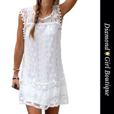 Gorgeous white lace dress Jump into Spring in this adorable white dress, fully lined, cute Pom Pom details around neckline and sleeves Dresses