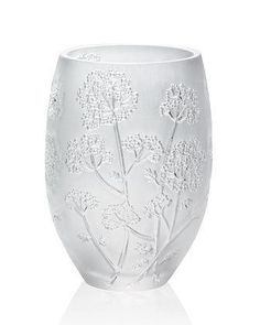 Stunning vase features a design inspired by the umbel flower, an Asian symbol of sovereignty. Made in France. Handcrafted of crystal. Hand wash. Approximately 5.125inDia. x 7inT. From..