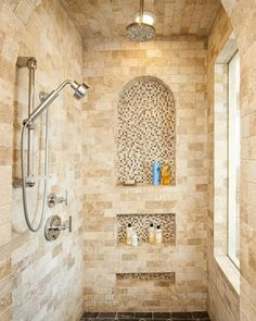 Pretty, coordinating tile for shower surround with built in soap shelf/shelves
