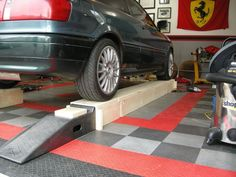 Awesome DIY car ramp!  The middle section comes out after the car is on.