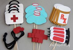 Nursing Doctor EMT Healthcare Graduation Toppers  24 fun and whimsical healthcare cupcake toppers, perfect for Doctor, Physicians Assistant, Registered Nurse, or Licensed Nurse Practitioner party! Celebrate a graduation, a new job or retirement!  4 of each; Red Cross, Prescription, Ice Bag, Needle, Dr. Bag and Stethiscope.. Papers and colors will vary. These toppers are made from multi layers of cardstock, not printed. Keep away from candles. Flat toothpick hidden in the layers. Toppers…