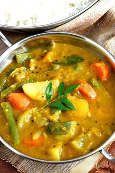"""Delicious South Indian Sambar Recipe: """"A ubiquitous spicy and tangy vegetable and split pea stew, there are as many recipes for this South Indian Sambar as there are families in southern India. Indian Food Recipes, Asian Recipes, Healthy Recipes, Ethnic Recipes, Indian Vegetable Recipes, South Indian Vegetarian Recipes, Kerala Recipes, Cheap Recipes, Healthy Food"""
