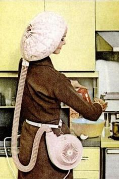 Portable Vintage hair dryer. A woman could cook clean and be pretty by the time hubby was home!