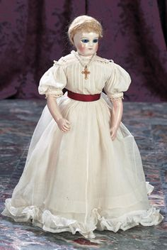 Marks: (Rohmer stamp on torso). Comments: Leontine Rohmer,the doll has three early deposed features of that firm: glass eyes,neck string attachment,and body sitting strings,circa 1860. Value Points: exquisite early doll whose rarity body features are rivaled by her beauty,lovely antique costume.