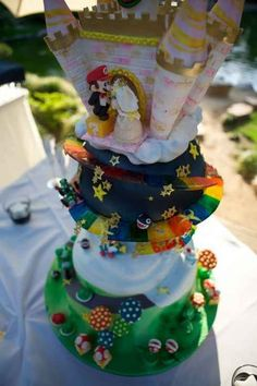 19 Spectacularly Nerdy Wedding Cakes.... Mario and princess wedding toppers