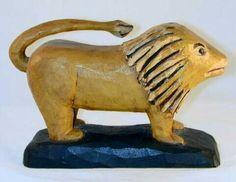 Antique American folk art - primitive carved wooden lion.