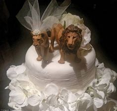 Safari-themed: Instead of a traditional bride and groom cake topper, Sophie and Lyndon opted for a lion and a lioness with a veil