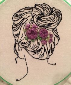 The purple lady is finished. I wish I had longer hair to put in a bun. I guess that's why I stitch them! .